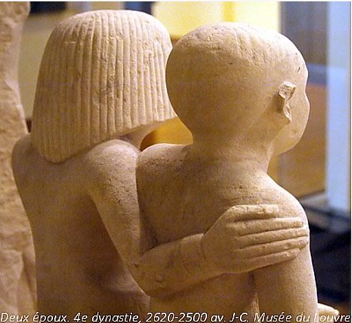 A married couple and their child, seen from behind, with the wife's hand on her husband's shoulder. 4th dynasty, 2620-2500 B.C. Musée du Louvre.